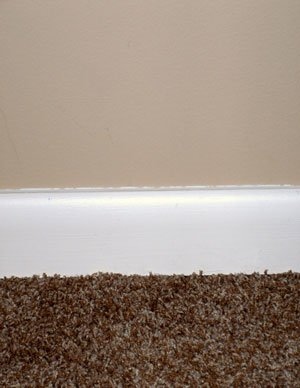 Basement carpeting tan frieze carpeting close up with - Carpet colors for white walls ...