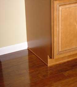 Buying laminate or hardwood flooring for Hardwood floors under cabinets