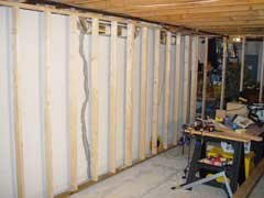 finish a basement when you have a long straight wall you can build